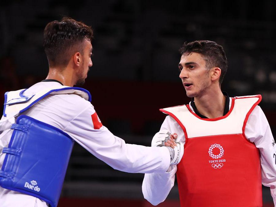 Tokyo 2020 Olympics - Taekwondo - Men's Flyweight - 58kg - Gold medal match - Makuhari Messe Hall A, Chiba, Japan - July 24, 2021. Vito Dell'aquila of Italy and Mohamed Khalil Jendoubi of Tunisia shake hands after competing REUTERS/Murad Sezer