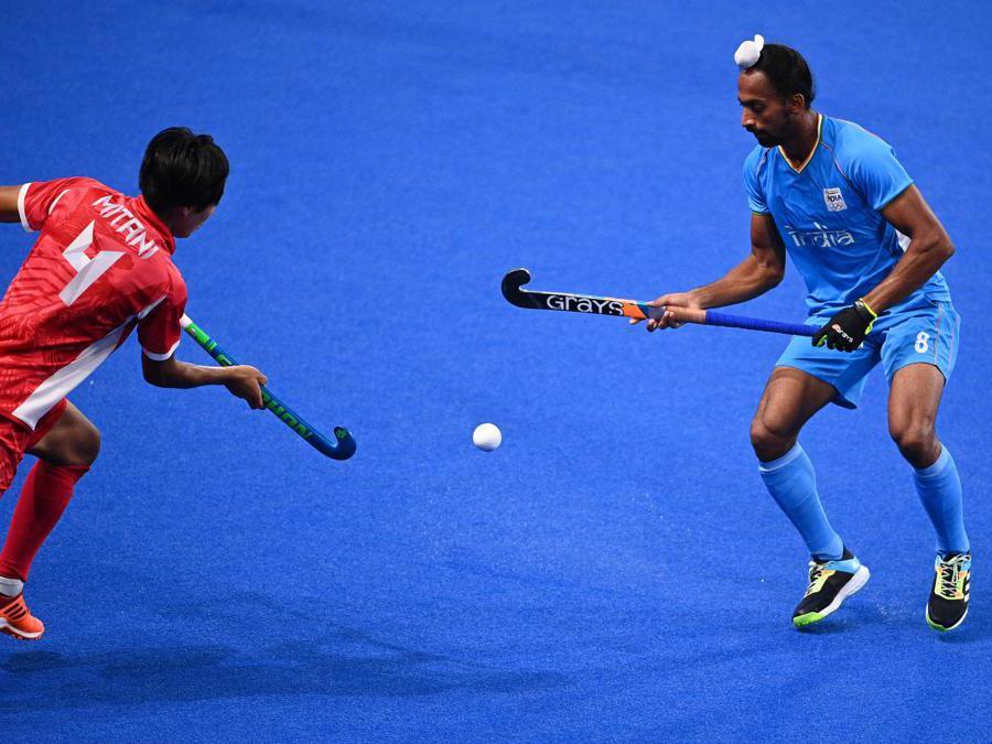 Jil giapponese  Genki Mitani e l'indiano Hardik Singh l (Photo by MARTIN BUREAU / AFP)