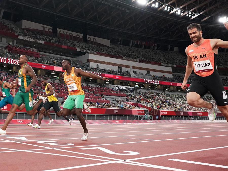 100m maschili  -  Hassan Taftian dell'Iran, Arthur Cisse della Costa d'Avorio e Akani Simbine del Sud Africa (Reuters/Peter Jebautzke)
