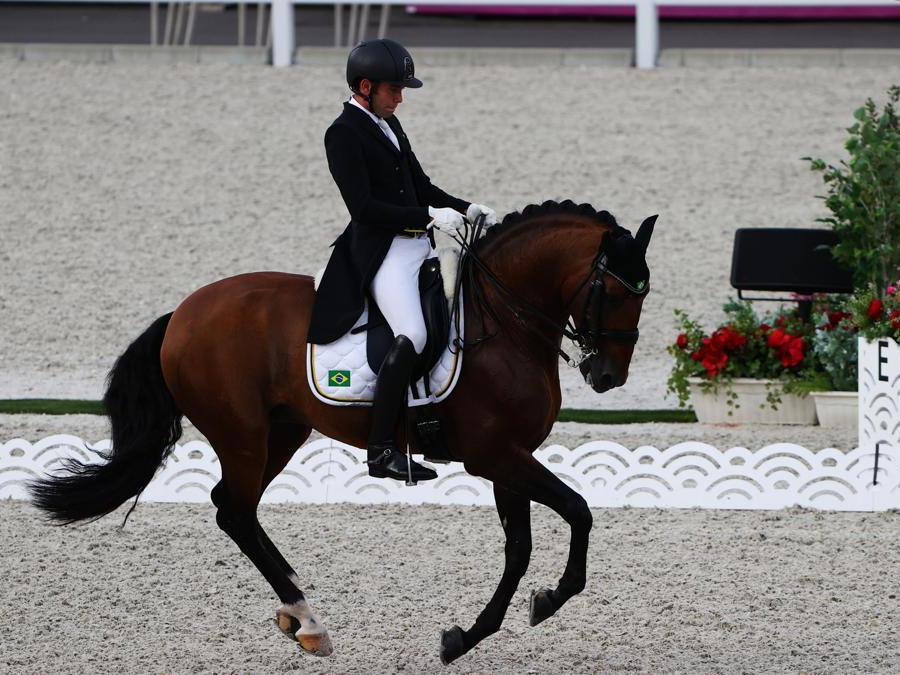 Dressage,  nella foto il brasiliano Joao Victor Marcari Oliva sul suo cavallo  Escorial (REUTERS/Alkis Konstantinidis)