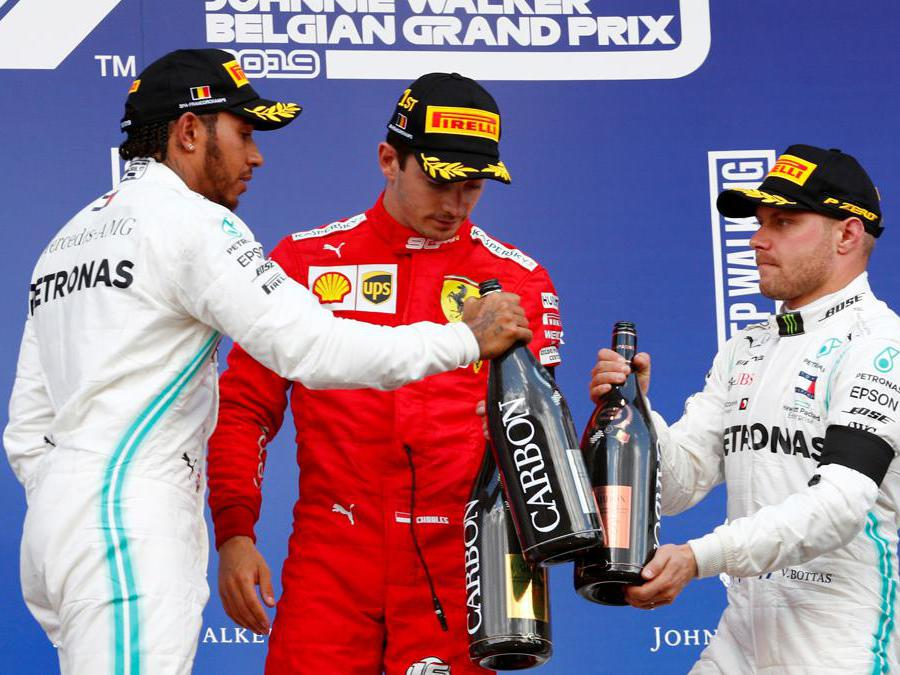Formula One F1 - Belgian Grand Prix - Spa-Francorchamps, Stavelot, Belgium - September 1, 2019 Ferrari's Charles Leclerc celebrates on the podium after winning the race with second placed Mercedes' Lewis Hamilton and third placed Mercedes' Valtteri Bottas REUTERS/Francois Lenoir