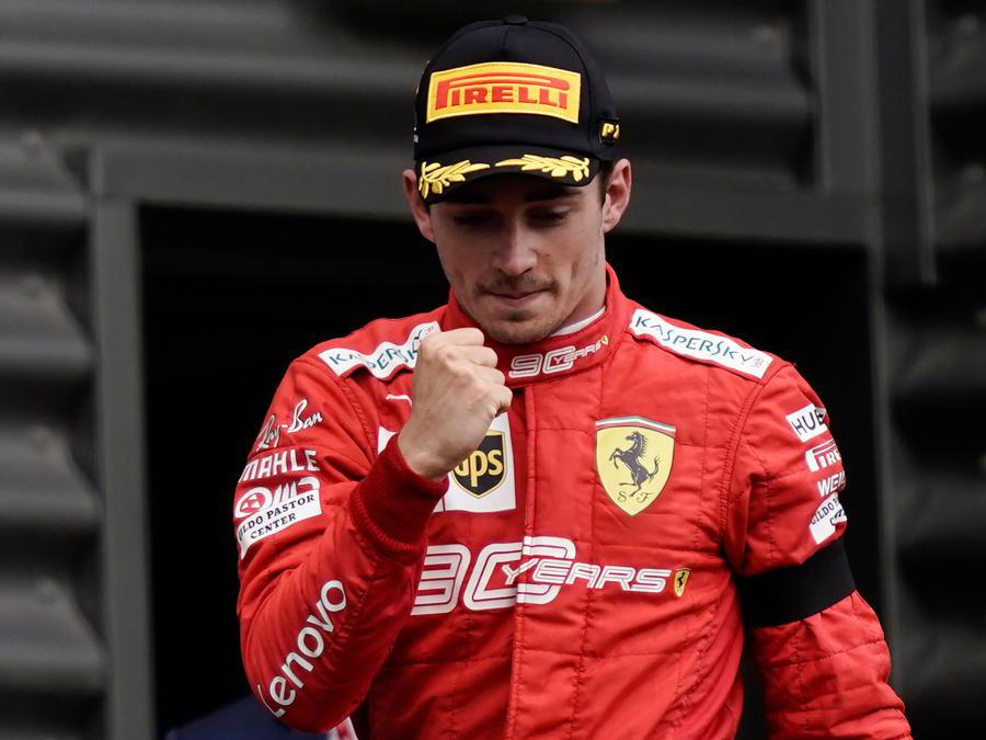 Winner Ferrari's Monegasque driver Charles Leclerc arrives to celebrate on the podium after the Belgian Formula One Grand Prix at the Spa-Francorchamps circuit in Spa on September 1, 2019. (Photo by Kenzo TRIBOUILLARD / AFP)
