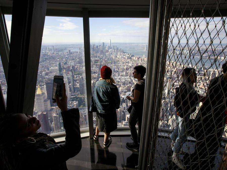 NEW YORK, NY - OCTOBER 10: Visitors walk through the newly renovated 102nd floor observatory of the Empire State Building on October 10, 2019 in New York City. Opening to the public on October 12, the new 102nd floor observatory is 1250 feet above street level and features 360 degree views of New York City. Drew Angerer/Getty Images/AFP == FOR NEWSPAPERS, INTERNET, TELCOS & TELEVISION USE ONLY ==